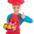 Studio portrait boy as little cook with cupcakes — Stock Photo #40252085