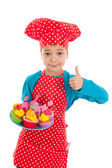 Studio portrait boy as little cook with cupcakes — Stock Photo
