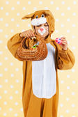 Child as easter hare with eggs — Stock Photo
