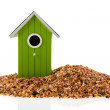 Green and red bird houses with seed — Stock Photo #40791369