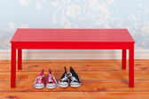 Hall with blue vintage wall paper and red bench — Stock Photo