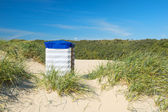 Borkum beach with typical chair — Stock Photo