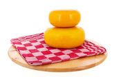 Cheese on cutting board — Stock Photo