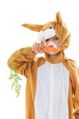 Child as easter hare with carrots — Stock Photo