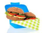 Healthy brown bread roll in blue lunch box — Stockfoto