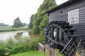 Dutch windmill near the river — Stock Photo