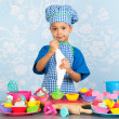 Little boy baking cupcakes — Stock Photo