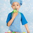 Little boy baking cupcakes — Stock Photo #44156399