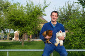 Farmer with chickens — Stock Photo