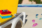 Yellow bed at swimming pool — Stock Photo