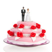 Mixed couple on top of wedding cake — Stock Photo