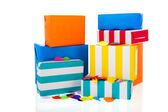 Striped presents with confetti — Stock Photo