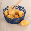Blue basket potatoes — Stock Photo #48205735