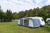 Caravan and shelter at the camping — Стоковое фото