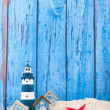 Beach houses and lighthouse — Stock Photo