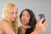 Girlfriends taking selfie while kissing — Stock Photo