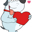 Gray Fat Dog Holding Up Red Heart — Stock Photo #19171927