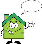 Green Eco House Character Waving For Greeting With Speech Bubble — Stock Photo