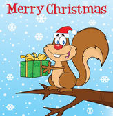 Squirrel With Santa Hat Holding A Gift Under Merry Christmas Text — Fotografia Stock