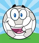 Happy Soccer Ball Cartoon Character On Grass — Stock Photo