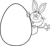 Black And White Cute Rabbit Cartoon Character Waving Behind Easter Egg — Stockfoto