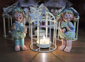 Three angels around a candle — Stockfoto