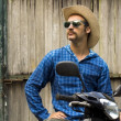Cowboy on motorbike — Stock Photo