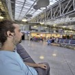 Young man waiting his flight in airport lounge — Stock Photo