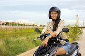 Sexy asian girl with mini skirt, helmet, motorcycle in cambodia — Stock Photo
