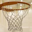 Scoring basket in basketball court — Stock Photo #14847555