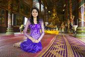 Asian girl praying in temple — Stock Photo