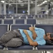 Sleeping in airport with eye cover - ストック写真