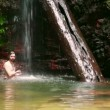 Caucasian man enjoying in waterfall under water — Stock Video