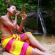Stock Video: Borneo Rainforest Tribal Culture: Face Painting