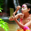 Borneo Rainforest Tribal Culture: Face Painting - Stock Photo