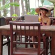 Asian freelance business woman at cafe with laptop and phone — Stock Video #19310213