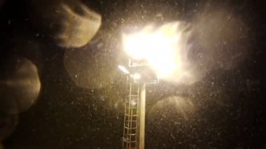 Floodlight and falling snow — Stock Video
