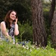 Beautiful girl talking on the phone in countryside  — Stock Video