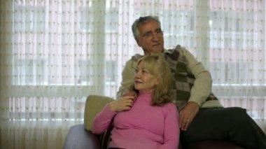 Senior couple talking while sitting on sofa — Stock Video