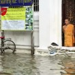 Buddhist monk in flood — Stock Video