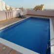Stock Video: Swimming pool at roof of apartment in bahrain