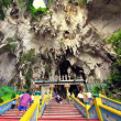 Stock Video: KUALLUMPUR - MARCH 2012: climbing batu caves steps