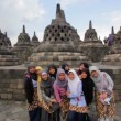 Stock Video: Indonesistudents visiting borobudur, indonesia