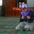 Stock Video: Muslim girl saying her everyday salat prayer