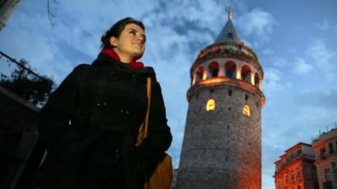 Cool woman standing at galata tower — Stockvideo
