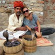 Stock Photo: Indian Cobra enchanter and tourist girl