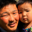 Stok fotoğraf: Mongolimposing with his daughter
