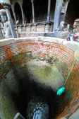 Pulling water containers from well — Photo