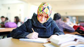 Muslim girl studying in library — Stock Photo