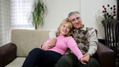 Senior couple sitting on sofa — Stock Photo